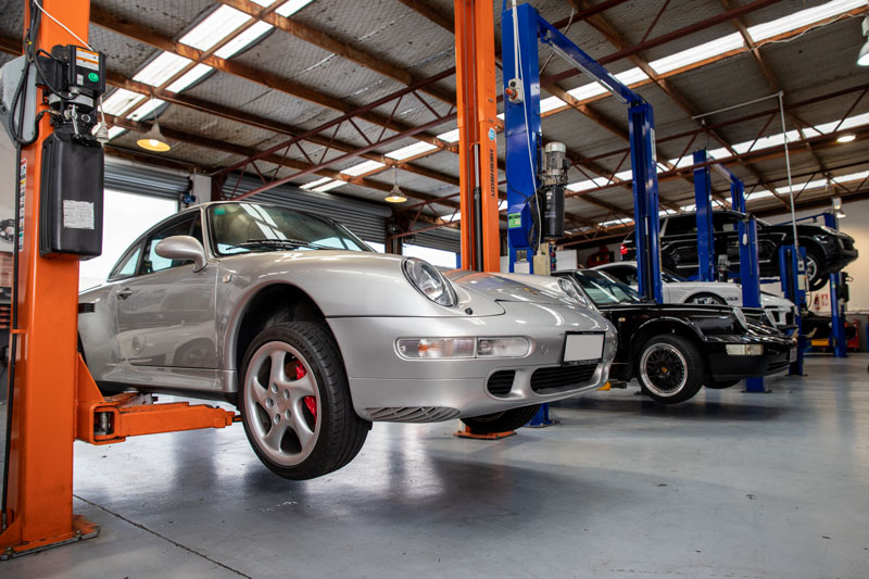 Silver Porsche on hoist